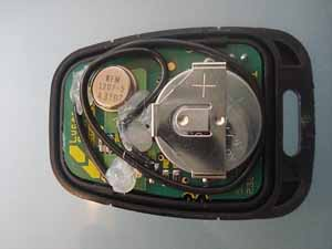 a picture of that modified key fob again - this time slightly larger  the  resonator can be seen to the left of the battery here - and you can just  make out